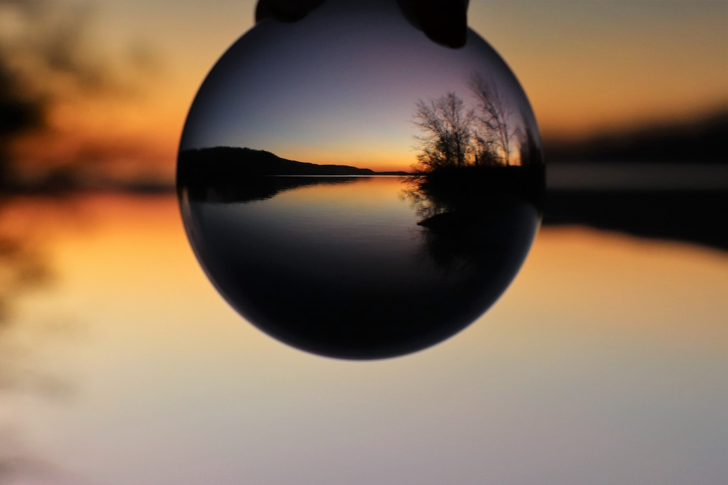 Photo shows sunset through a Glass Ball at Beltzville Dam & Reservoir in Pennsylvania