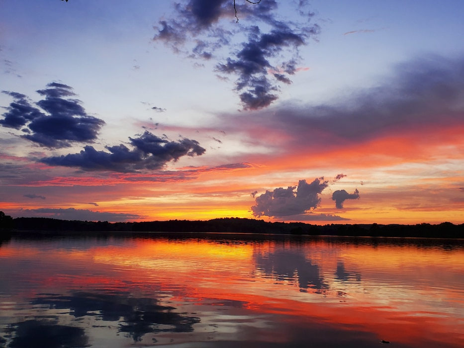 Photo shows a vibrant and colorful sunset at Blue Marsh Lake