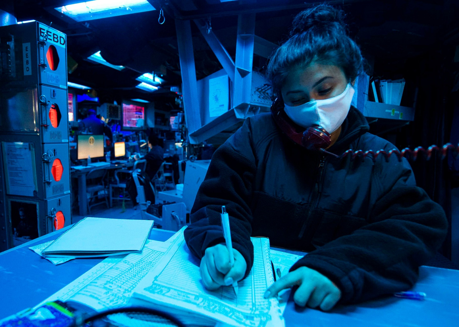 TAIWAN STRAIT (Dec. 30, 2020) Operations Specialist Seaman Jennifer Diaz, from Brooklyn, NewYork, writes in a deck log in the combat information center as guided-missile destroyer USS Curtis Wilbur (DDG 54) conducts routine operations. Curtis Wilbur is forward-deployed to the U.S. 7th Fleet area of operations in support of a free and open Indo-Pacific.