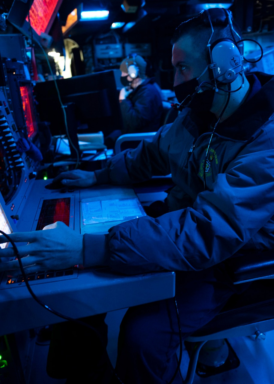 TAIWAN STRAIT (Dec. 30, 2020) Operations Specialist 3rd Class Christian Cordero, from Dallas, operates a console in the combat information center as guided-missile destroyer USS Curtis Wilbur (DDG 54) conducts routine operations. Curtis Wilbur is forward-deployed to the U.S. 7th Fleet area of operations in support of a free and open Indo-Pacific.