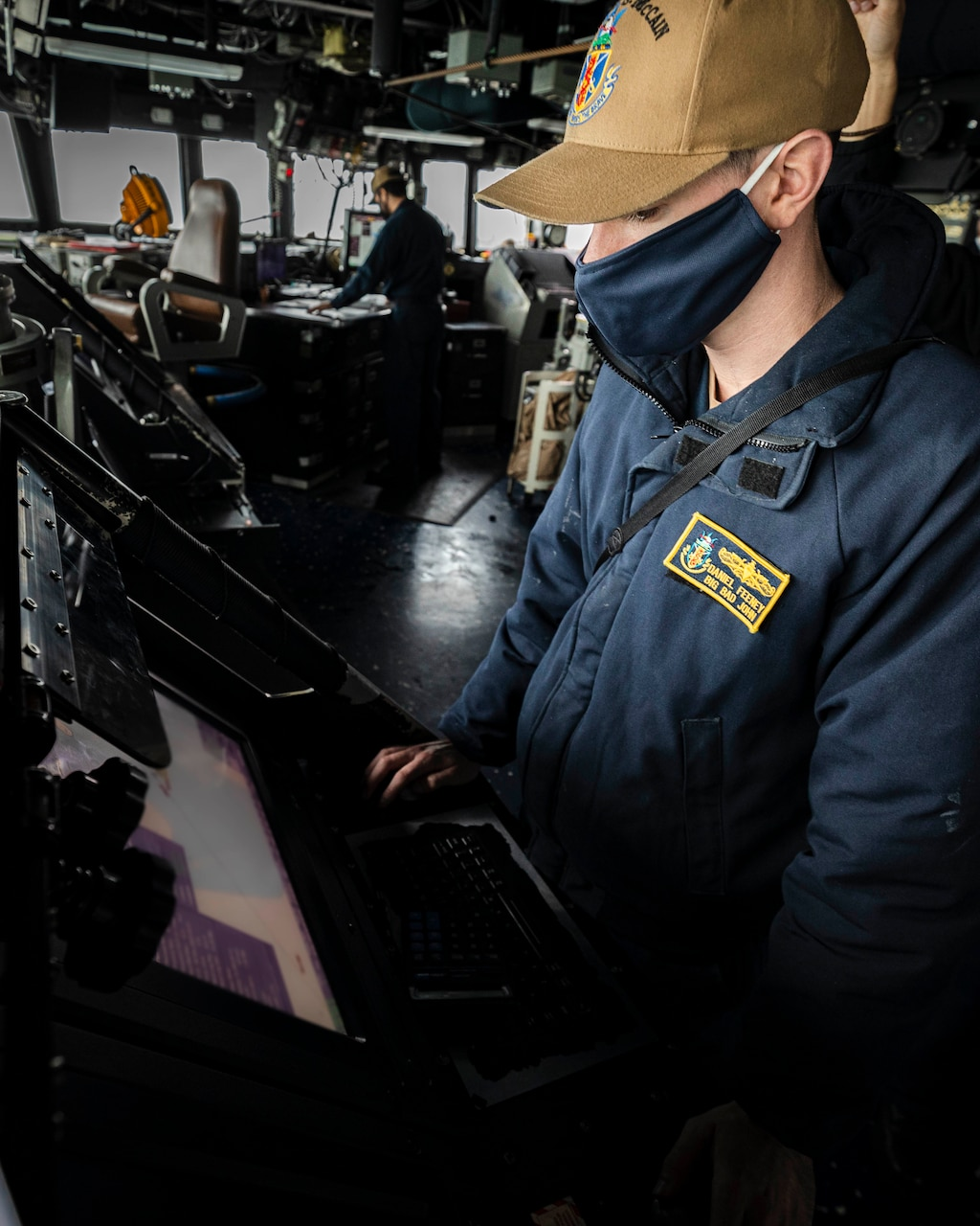 TAIWAN STRAIT (Dec. 30, 2020) Navigator Lt. j.g. Daniel Feeney, from Old Greenwich, monitors the ship's course on the voyage management system (VMS) while standing watch in the pilot house as the guided-missile destroyer USS John S. McCain (DDG 56) conducts routine underway operations in support of stability and security for a free and open Indo-Pacific.