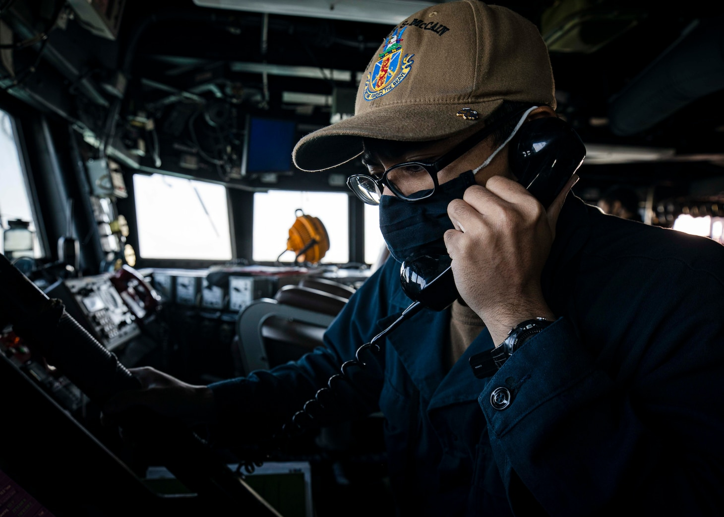 TAIWAN STRAIT (Dec. 30, 2020) Ensign Ryan Richards completes a maneuvering board on the bridge as guided-missile destroyer USS Curtis Wilbur (DDG 54) conducts routine operations. Curtis Wilbur is forward-deployed to the U.S. 7th Fleet area of operations in support of a free and open Indo-Pacific. Sea control is foundational for all other naval missions that support the Joint Force, including power projection. (U.S. Navy Photo by Mass Communication Specialist 2nd Class Benjamin T. Liston)