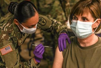 Service member receives vaccine