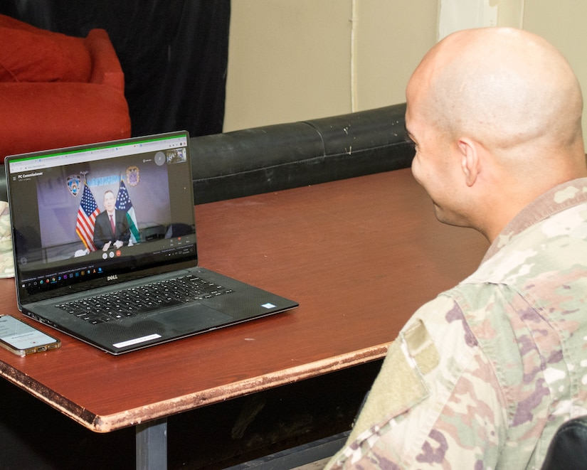 New York Police Officer and U.S. Army Staff Sgt. Samuel Garcia, intelligence analyst noncommissioned officer, 719th Movement Control Battalion, receives a special holiday call from New York City Police Commissioner Dermot Shea at Camp Arifjan, Kuwait, Dec. 23, 2020. During the call Shea thanked Garcia for his continued service to the nation as he serves his country in support of Operation Spartan Shield.