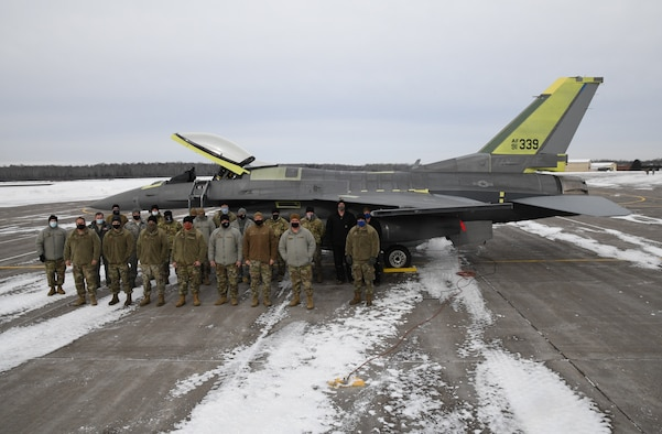 148th Maintenance Group personnel and Lt. Col. R. Matt Russell, Chief of F-16 Flight Tests and pilot for the F-16 System Program Office at Hill Air Force Base pose for a photo when aircraft 339, an F-16 that was severely battle damaged in 2018, was returned to the 148th Fighter Wing.