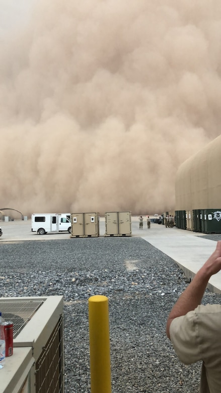 A dust storm approaches the work areas of deployed Airmen at the 407th Air Expeditionary Group, Ahmad al-Jaber Air Base, Kuwait in 2018. (Courtesy photo from Chief Master Sgt. Ryan Gigliotti)
