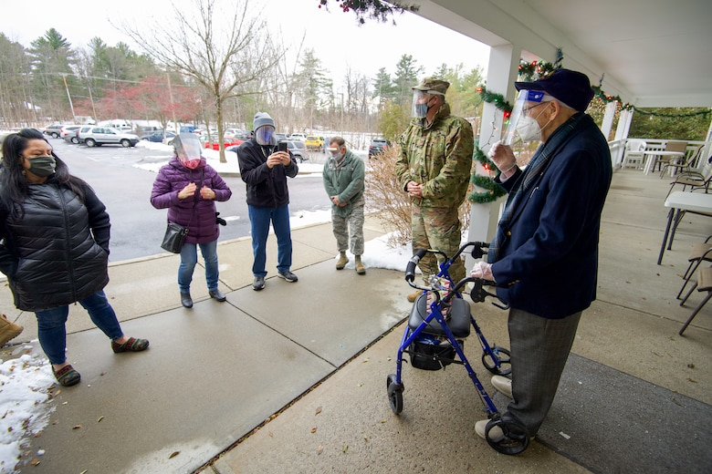World War II veteran Lenny Roberge, Vermont's oldest living veteran, says a few words of thanks to the Airmen of the Vermont Air National Guard at a small ceremony outside his nursing home in South Burlington, Vt., Dec. 22, 2020. In order to honor Roberge, Airmen from the 158th Fighter Wing had a flag flown in an F-35 during a combat training sortie over the mountains of Vermont and New York. (U.S. Air National Guard photo by Senior Master Sgt. Michael Davis)