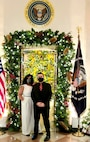 Nicole Barber-White and her husband, Master Sgt. James White, 8th Intelligence Squadron flight chief, conclude their time decorating the White House for the holidays in Washington, D.C., Nov. 28, 2020. Barber-White started decorating the homes of the president and vice president in 2012, and her husband began in 2017. (Courtesy Photo)