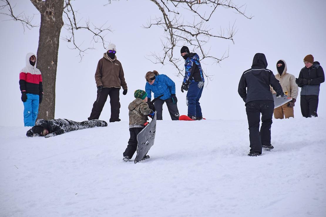 Families sledding