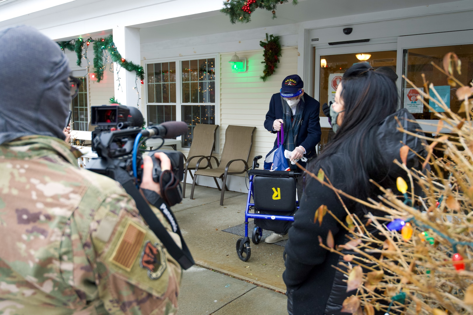 World War II veteran Lenny Roberge, Vermont's oldest living veteran, prepares to hand out to Airmen present apple pie he baked in appreciation for receiving a flag flown in the F-35, at a small ceremony outside his nursing home in South Burlington, Vt., Dec. 22, 2020. In order to honor Roberge, Airmen from the 158th Fighter Wing had a flag flown in an F-35 during a combat training sortie over the mountains of Vermont and New York. (U.S. Air National Guard photo by Senior Master Sgt. Michael Davis)