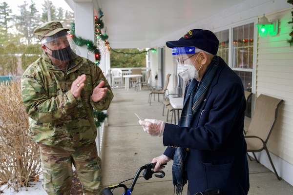 Col. Adam Rice (left), vice wing commander of the 158th Fighter Wing, Vermont Air National Guard, thanks WWII veteran Lenny Roberge, Vermont's oldest living veteran, for his military service at a small ceremony in South Burlington, Vt., Dec. 22, 2020. In order to honor Roberge, Airmen from the 158th Fighter Wing had a flag flown in an F-35 during a combat training sortie over the mountains of Vermont and New York. (U.S. Air National Guard photo by Senior Master Sgt. Michael Davis)