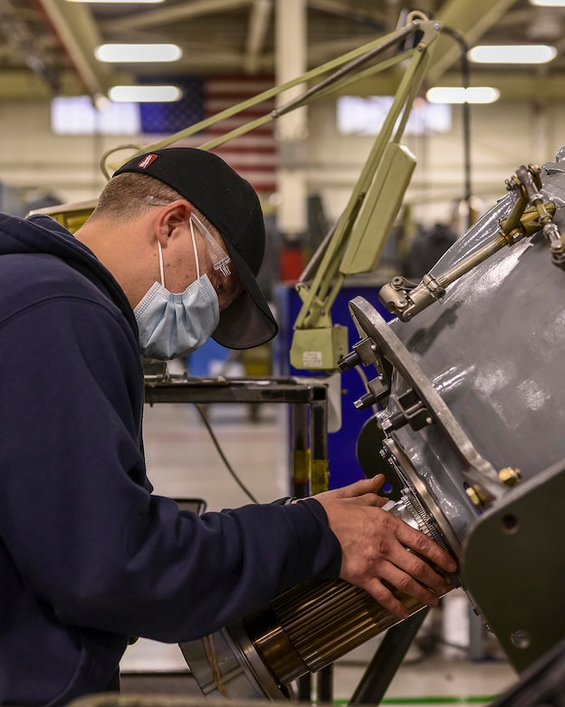 Contract Field Team member, Jon Hart, cleans and inspects an engine reduction gear box, Dec. 29, 2020, at Little Rock Air Force Base, Ark. The facility produces all C-130H Hercules 3.5 engine modifications and 54H60-117 propeller overhauls for Air Force Reserve Command  and many Air National Guard units. (U.S. Air Force Reserve photo by Maj. Ashley Walker)