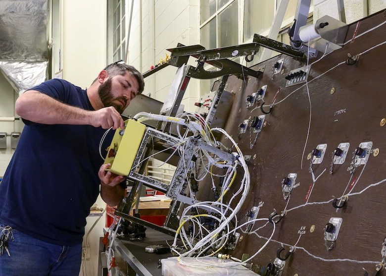 Dave Embler, Contract Field Team member, assembles and tests the wiring harness for a refurbished Quick Engine Change kit QEC on a wiring board prior to installation, Dec. 29, 2020, at Little Rock Air Force Base, Ark. The facility produces all C-130H Hercules 3.5 engine modifications and 54H60-117 propeller overhauls for Air Force Reserve Command and various Air National Guard units. (U.S. Air Force Reserve photo by Maj. Ashley Walker)