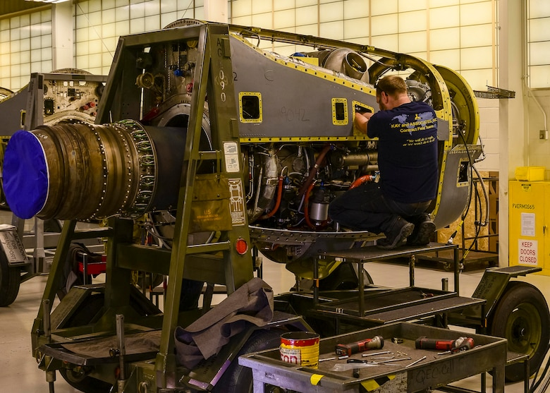 Contract Field Team member, Jack Mason, assembles a refurbished T-56 engine on an engine stand prior to final testing and inspection, Dec. 29, 2020, at Little Rock Air Force Base, Ark. The facility produces all C-130H Hercules T-56 3.5 modified engine and 54H60-117 propeller overhauls for Air Force Reserve Command and various Air National Guard units. (U.S. Air Force Reserve photo by Maj. Ashley Walker)