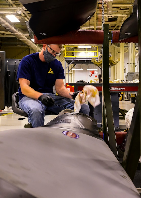 Tom Spuhler, a Contract Field Team member, inspects and cleans a propeller blade prior to assembly on, Dec. 29, 2020, at Little Rock Air Force Base, Ark. The facility produces all C-130H Hercules T-56 3.5 modified engine and 54H60-117 propeller overhauls for Air Force Reserve Command and various Air National Guard units. Since 2015, 395 C-130H four bladed props received intensive maintenance. (U.S. Air Force Reserve photo by Maj. Ashley Walker)