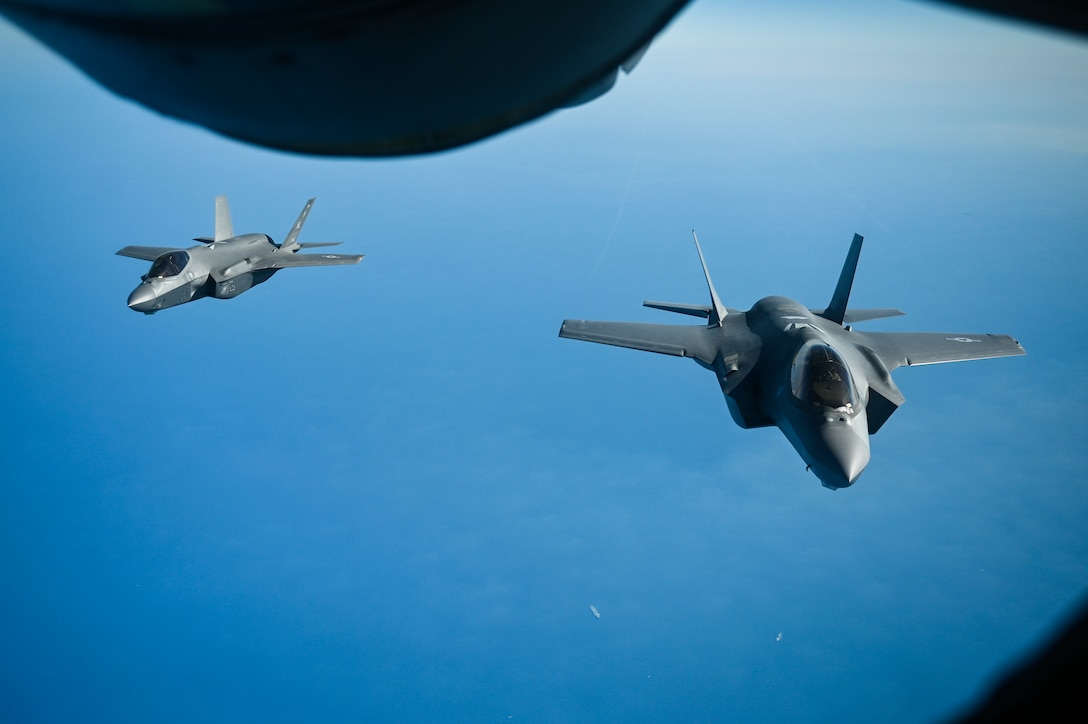 Two U.S. Air Force F-35A Lighting II's fly over the Arabian Gulf during an in-air refueling mission with a U.S. Air Force KC-135 Stratotanker assigned to the 28th Expeditionary Air Refueling Squadron, deployed to Al Udeid Air Base, Qatar, Jan. 17, 2020.
