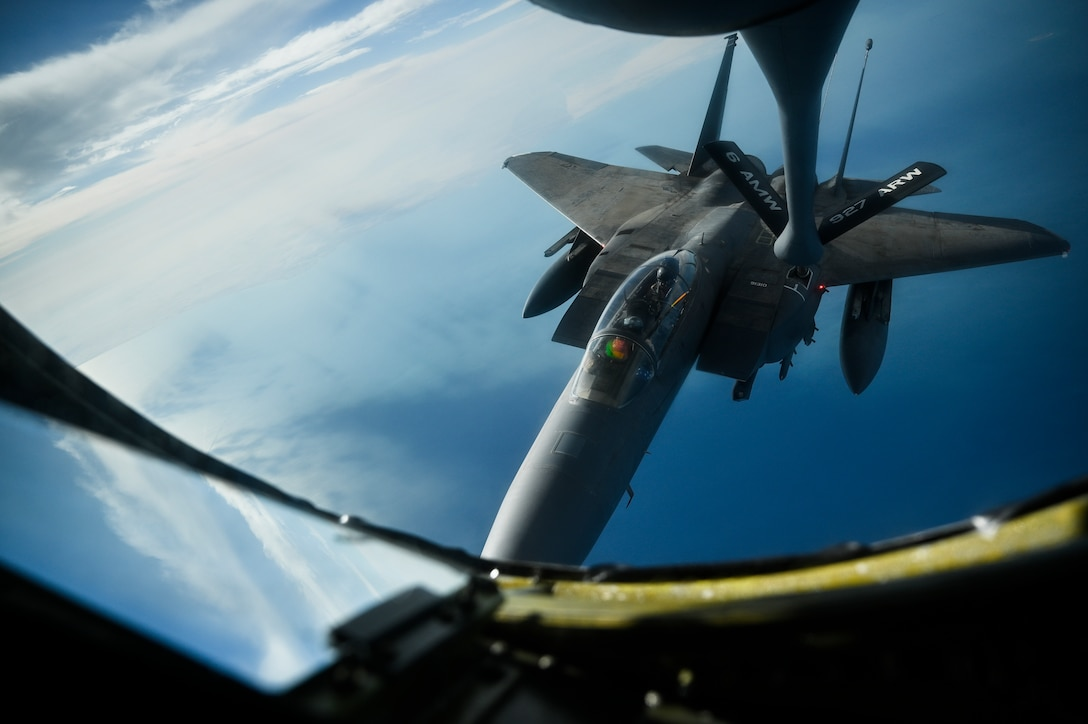 A U.S. Air Force F-15E Strike Eagle receives fuel from a U.S. Air Force KC-135 Stratotanker assigned to the 28th Expeditionary Air Refueling Squadron, deployed to Al Udeid Air Base, Qatar, WHERE, Jan. 17, 2020.