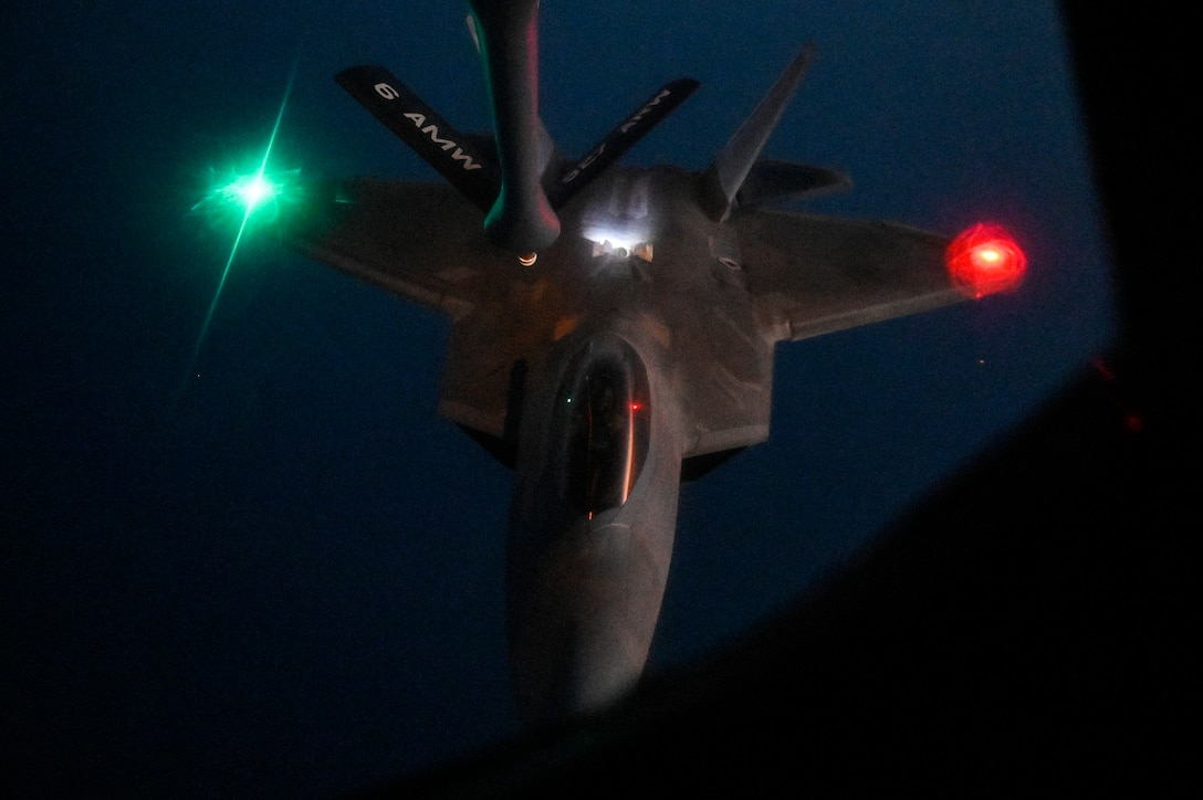 A U.S. Air Force F-22 Raptor approaches the boom of a U.S. Air Force KC-135 Stratotanker assigned to the 28th Expeditionary Air Refueling Squadron, deployed to Al Udeid Air Base, Qatar, to conduct an in-air refueling mission WHERE, Jan. 17, 2020.