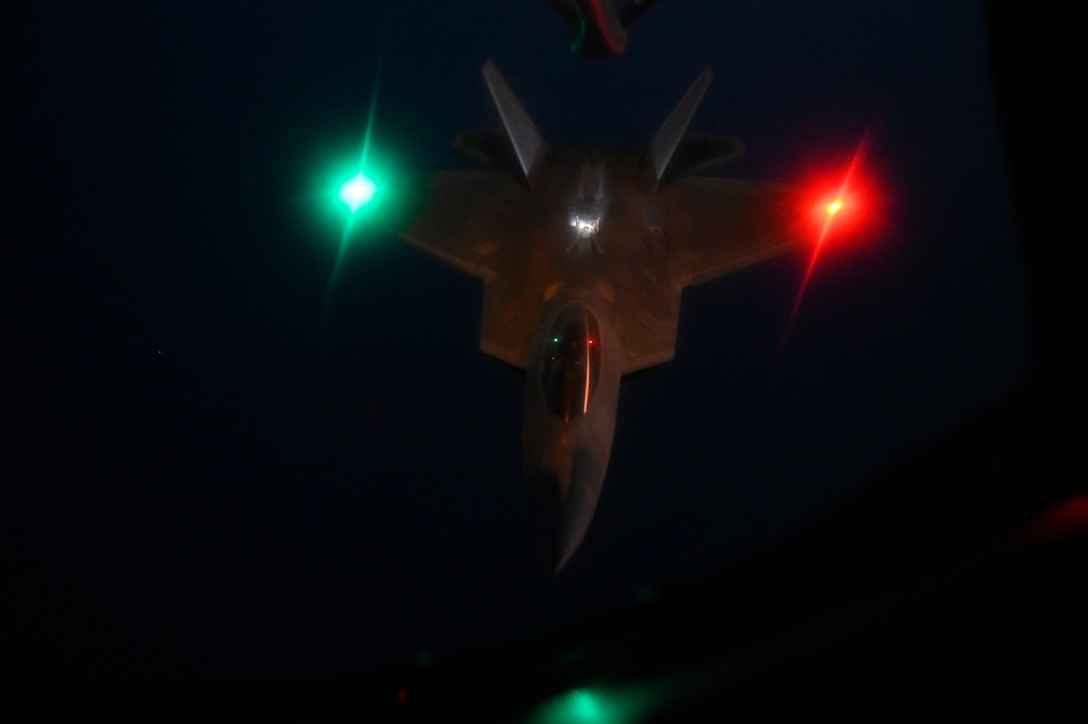 A U.S. Air Force F-22 Raptor flies over the Arabian Gulf during an in-air refueling mission with a U.S. Air Force KC-135 Stratotanker assigned to the 28th Expeditionary Air Refueling Squadron, deployed to Al Udeid Air Base, Qatar, Jan. 17, 2020.
