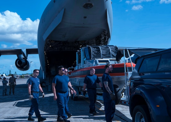 Joint Maritime Safety and Security Teams from the Coast Guard load a USCG vessel during exercise Patriot Palm, Jan. 30, 2020, at Kalaeloa Airport, Hawaii. A team of several military branches participated with the 315th Contingency Response Flight from Joint Base Charleston in support of exercise Patriot Palm. (U.S. Air Force photo by Tech. Sgt. Della Creech)