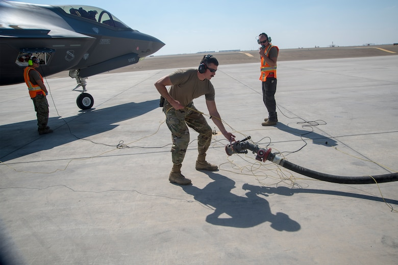 Members of the 380th Expeditionary Aircraft Maintenance and Logistics Readiness Squadrons hot pit refuel an F-35A Lightning II on the Al Dhafra Air Base flightline, United Arab Emirates, Jan. 29, 2020. A hot pit refueling is the process in which ground crew Airmen refuel an aircraft while its engines are still running, minimizing the time required to get the aircraft airborne again. This capability enhances the readiness of the wing and ability to execute the air tasking order. (U.S. Air Force photo by Staff Sgt. Anna-kay Ellis)