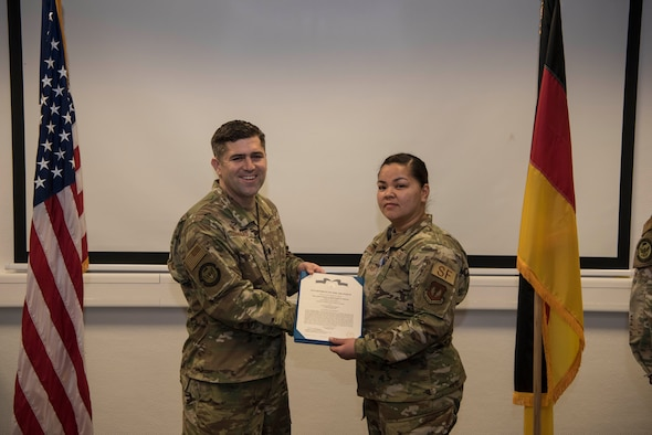 Technical Sgt. Heather R. Sanchez, 86th Security Forces Squadron Installation Access non-commissioned officer in charge, receives the U.S. Air Force Achievement Medal on Ramstein Air Base, Germany, Jan. 17, 2020. Sanchez received this award after saving the life of a mother visiting on base to see her son's place of work.