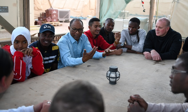 Members of the local English Discussion Group talk with U.S. military personnel at Nigerien Air Base 201, Niger, Feb. 1, 2020. Invited on base by members of the U.S. Army 443rd Civil Affairs Battalion Civil Affairs Team 219, the group continually improves their language skills by talking to native English speakers. (U.S. Air Force photo by Tech. Sgt. Alex Fox Echols III)