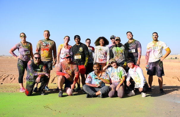 Color run participants pose for a photo after completing the event at Nigerien Air Base 201, Niger, Feb. 2, 2020. More than 30 runners and volunteers participated in the event. (U.S. Air Force photo by Tech. Sgt. Alex Fox Echols III)