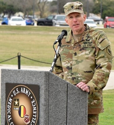 Command Sgt. Maj. Clark J. Charpentier, incoming U.S. Army Medical Center of Excellence Command Sergeant Major, addresses the audience at the MacArthur Parade Field at Joint Base San Antonio-Fort Sam Houston Jan. 31.