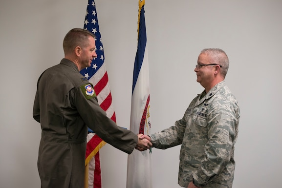 Col. Marty Timko, 167th Airlift Wing commander, congratulates Lt. Col. Charles Nasser during a ceremony marking Nasser's assumption of command of the 167th Mission Support Group, Feb. 1, 2020.