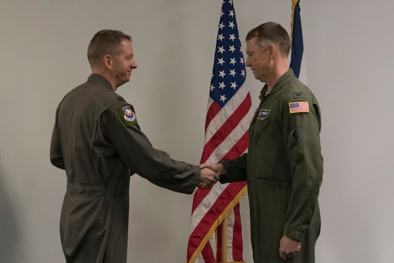 Col. Marty Timko, 167th Airlift Wing commander, congratulates Col. Christopher Sigler upon his assumption of command of the 167th Operations Group during a ceremony at the 167th Airlift Wing, Feb. 2, 2020.