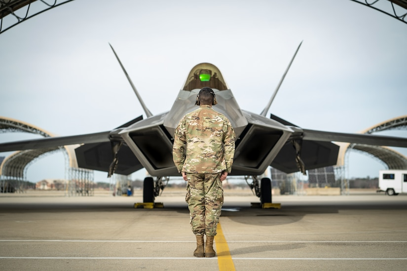 A U.S. F-22 Raptor assigned to the F-22 Demo Team prepares to be launched out by a crew chief at Joint Base Langley-Eustis, Va., Jan. 30, 2020.