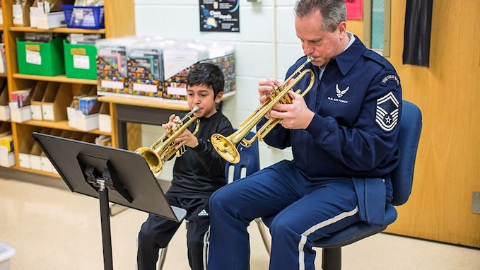 For the entire school year our Advancing Innovation through Music (AIM) program supported local educational outreach program Bridges: Harmony Through Music.  We were honored to be presented the Community Partner of the Year award by founding director Bonny Tynch.  Pictured is Senior Master Sgt. Kevin Burns working with a young trumpet student at a Bridges event.  (U.S. Air Force Photo/released)