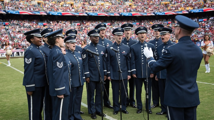 Members of the Singing Sergeants, conducted by Capt. Dustin Doyle perform the National Anthem prior to a Washington Redskins game at FedEx Field in 2017 (U.S. Air Force Photo by CMSgt Bob Kamholz/Released)