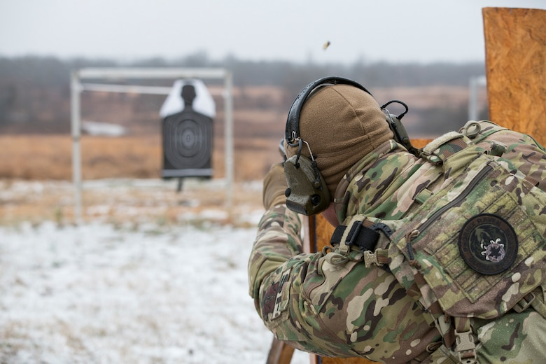 Master Sgt. Gregory Wardle, 153rd Security Forces Squadron, conducts pistol drills Jan. 22, 2020, at Ft. Chaffee, Arkansas. Wardle is part of the Air National Guard's Defender Challenge team, composed of Airmen from across the ANG who gathered at Ft. Chaffee to train for the upcoming competition. (U.S. Air National Guard photo by Airman 1st Class Christopher Sherlock)