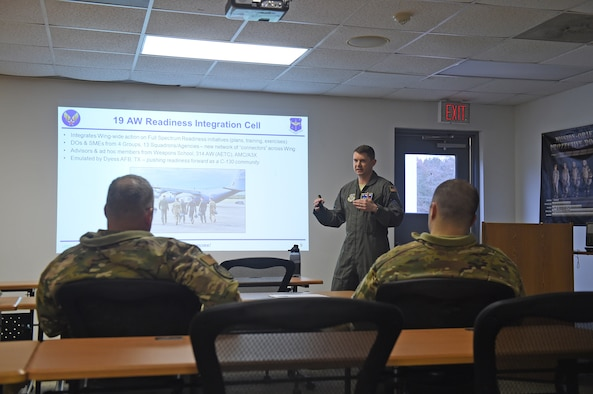 Airmen receive a briefing by PowerPoint