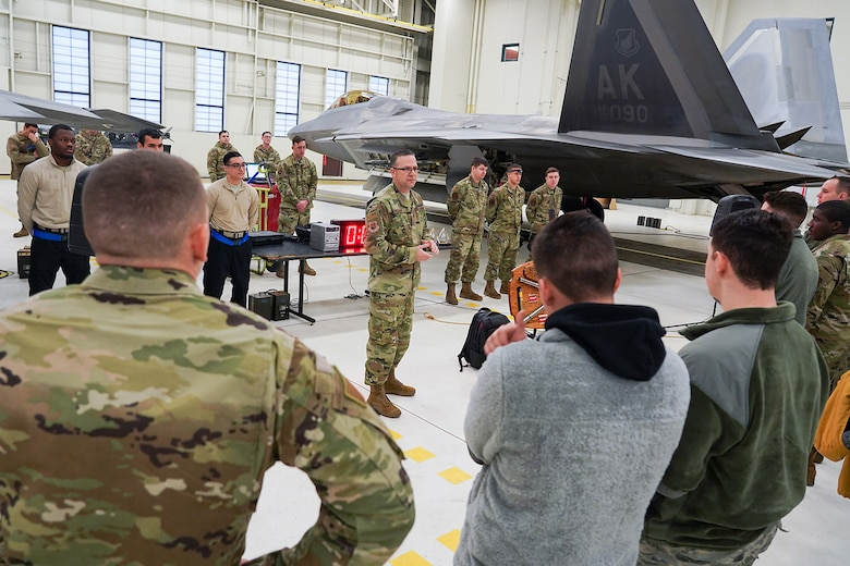 Airmen assigned to the 90th and 525th Aircraft Maintenance Units compete during a timed F-22 Raptor load crew competition on Joint Base Elmendorf-Richardson, Alaska, Jan. 31, 2020.