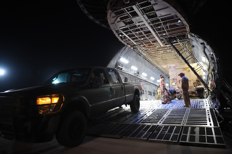 Airmen from the 621st Contingency Response Group help offload equipment from a C-5M Super Galaxy at Prince Sultan Air Base, Kingdom of Saudi Arabia, June 26, 2019. The 621st CRG deployed for an air base opening mission in response to the White House authorization of approximately 1,000 additional troops in U.S. Central Command's area of responsibility for defensive purposes to address air, naval, and ground-based threats in the Middle East. (U.S. Air Force photo by Staff Sgt. Sarah Brice)