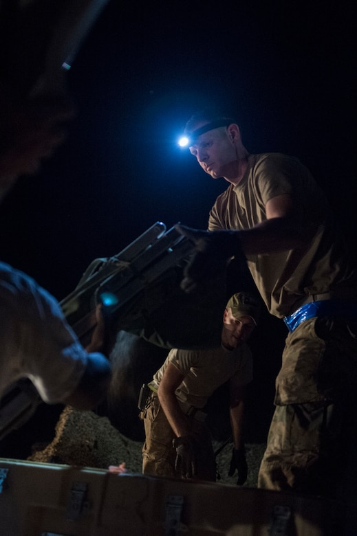Airmen from the 621st Contingency Response Group pack supplies onto a pallet in preparation to redeploy at Prince Sultan Air Base, Kingdom of Saudi Arabia, July 27, 2019. Most construction and deconstruction operations take place at night to avoid heat-related complications. The 621st CRG deployed for an air base opening mission in response to the White House authorization of approximately 1,000 additional troops in U.S. Central Command's area of responsibility for defensive purposes to address air, naval, and ground-based threats in the Middle East. (U.S. Air Force photo by Staff Sgt. Sarah Brice)