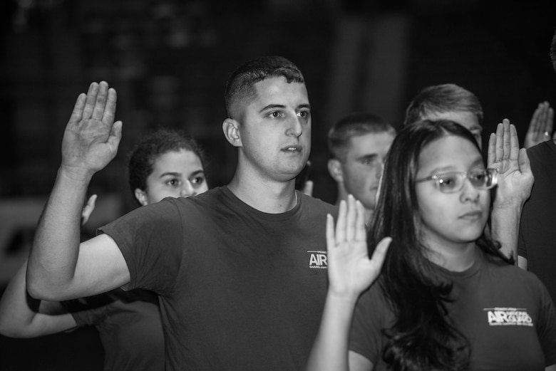 More than 60 U.S. Air Force and Army recruits recite the oath of enlistment during a mass-enlistment at the Pennsylvania Farm Show Jan. 9, 2020, in Harrisburg, Pennsylvania
