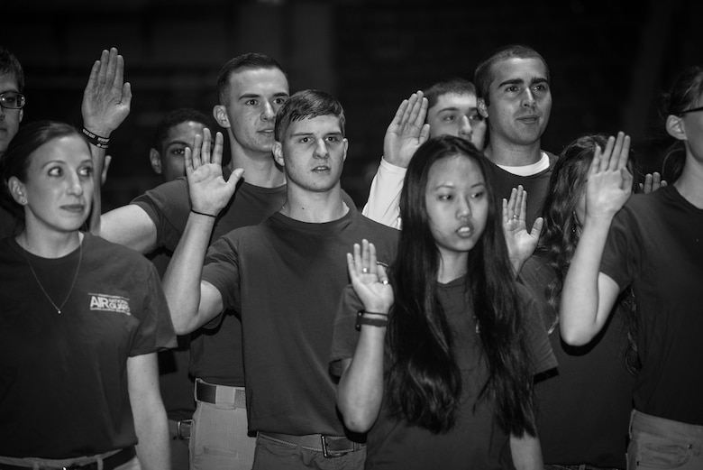 More than 60 U.S. Air Force and Army recruits recite the oath of enlistment during a mass-enlistment at the Pennsylvania Farm Show Jan. 9, 2020, in Harrisburg, Pennsylvania.