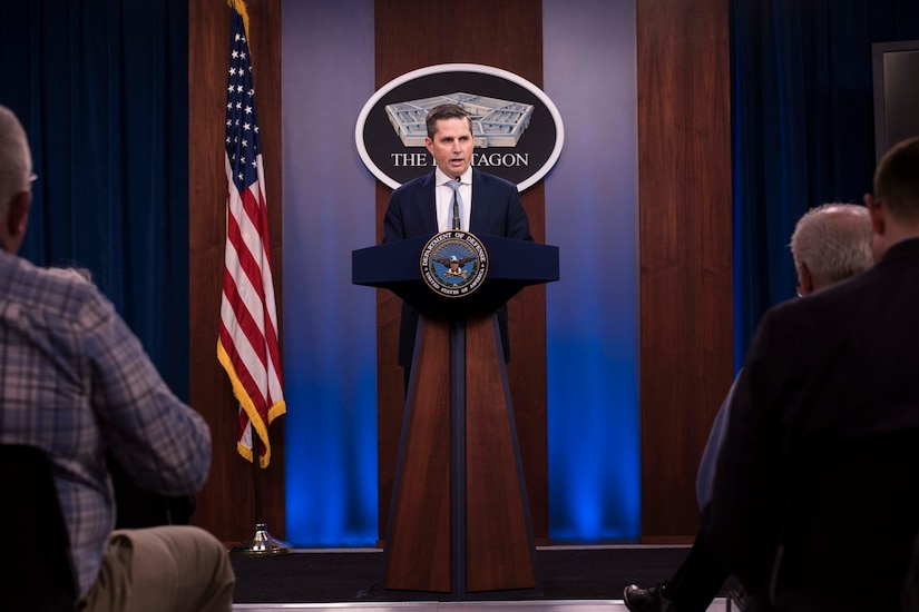 A man speaks from a podium.