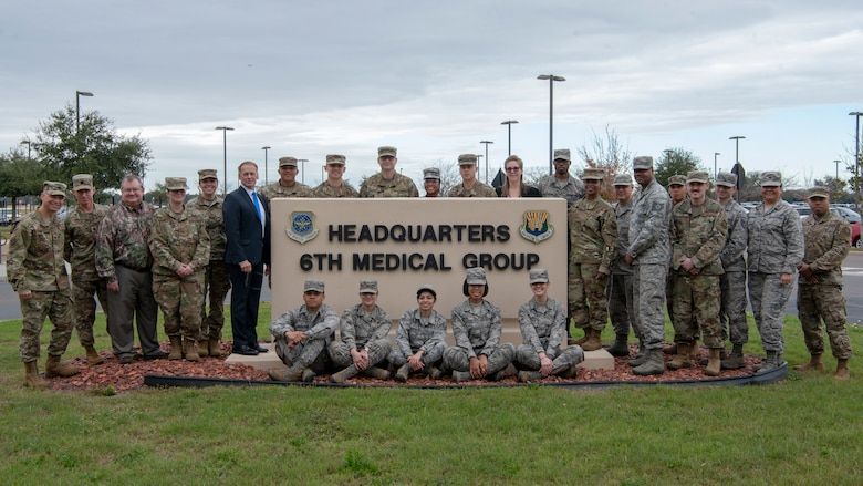 The Biomedical Science Corps (BSC) team members pose around the 6th Medical Group headquarters sign at MacDill Air Force Base, Fla. Jan 27, 2020. The roots of the BSC date to 1917 with the Army Sanitary Corps and was established within the Air Force Medical Service in 1965 to help provide oversight of the scientific and engineering elements of medical care. (U.S. Air Force photo by Airman First Class David D. McLoney)