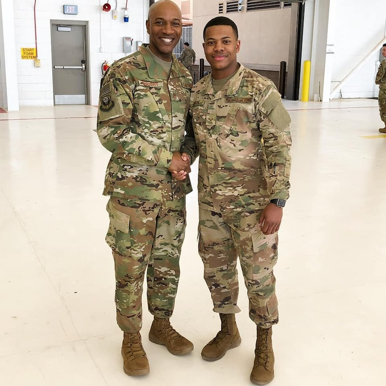 Staff Sgt. TeDera Graves II, 27th Special Operations Logistics Readiness Squadron commander's support staff non-commissioned officer in charge, shakes hands with Chief Master Sgt. of the Air Force Kaleth O. Wright during an all-call at Cannon Air Force Base, New Mexico, March 23, 2019. Wright shared this photo of himself and Graves on his Facebook page in December 2019, calling Graves a 'legend' in the post. (Courtesy photo)