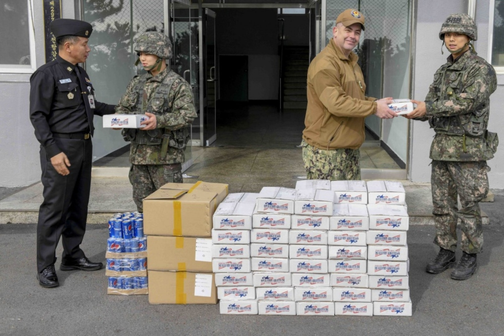 Commander, Naval Forces Korea Sailors and ROK MCPON Deliver Care Packages to Korean Sailors
