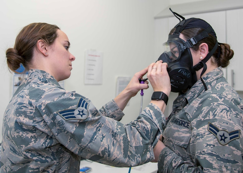 Senior Airman Mary Hicks, 4th Operational Medical Readiness Squadron bioenvironmental engineering journeyman, prepares to administer a gas mask fit test on, Airman 1st Class Cassandra Hart, 704th Aircraft Maintenance Squadron personnel apprentice, Jan. 23, 2020, at Seymour Johnson Air Force Base, N.C.