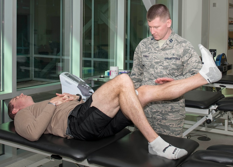 Capt. Ryan Knight, 4th Operational Medical Readiness Squadron physical therapist, preforms neuromuscular electrical stimulation (NMES) on, Maj. Dusten Weathers, 334th Flight Squadron assistant director of operations, Jan. 29, 2019, at the Thomas Koritz Clinic on Seymour Johnson Air Force Base, N.C.