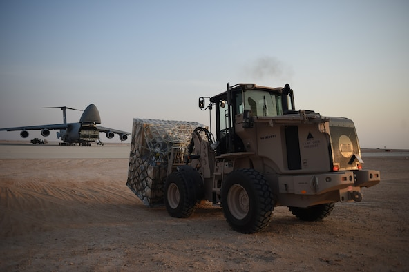 An Airman from the 621st Contingency Response Group helps offload cargo from a C-5M Super Galaxy at Prince Sultan Air Base, Kingdom of Saudi Arabia, June 25, 2019. The 621st CRG deployed for an air base opening mission in response to the White House authorization of approximately 1,000 additional troops in U.S. Central Command's area of responsibility for defensive purposes to address air, naval, and ground-based threats in the Middle East. (U.S. Air Force photo by Staff Sgt. Sarah Brice)