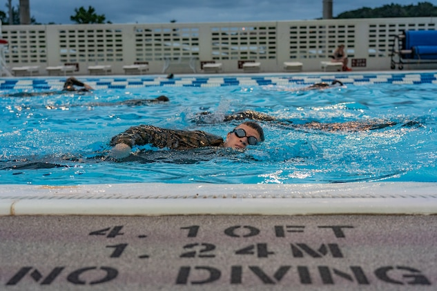 U.S. Marine Corps Lance Cpl. Caelan Long, a supply chain and material management specialist with Marine Wing Support Squadron 172, completes a timed swim Jan. 29, 2020, at Fairchild Pool on Kadena Air Base, Okinawa, Japan.