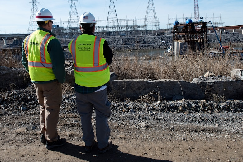 Don Getty (Right), U.S. Army Corps of Engineers Nashville District project manager for the Kentucky Lock Addition Project, and Barney Schulte, the project's lead engineer, monitor the progress of the placement of the final concrete shell on the riverbed of the Tennessee River Feb. 2, 2020 below Kentucky Lock in Grand Rivers, Ky. The Corps and contractor, Johnson Brothers, placed the 10th concrete shell that is part of the permanent downstream lock wall and will double as part of a coffer dam for the Kentucky Lock Addition Project. (USACE photo by Lee Roberts)